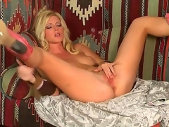 Blond temptress, named Niki Young, demonstrates on the camera how this babe masturbates her pussy. Babe makes her hole wet by gentle touches on her sensitive boobies.