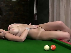 Horny and aroused brunette milf LaTaya Roxx with large honkers enjoys in spreading her legs and playing with some pool balls ont he pool table in front of the cam