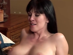 The young gracious pornstar Johnny Castle seduces his allies MILF mom RayVeness with a big natural boobies. He starts to kiss her lovely lips and helps to undress. They look very happy.