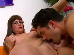 Brunette hair milf with long hair and glasses Alexandra Silk gets her hairy twat licked and fingered by a turned on man Giovanni Francesco on the couch i the living room and enjoys