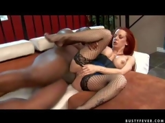 Experienced curvy redhead milf Shannon Kelly with big fake balloons and bouncing arse in fishnet nylons acquires her shaved minge pounded hard by tall black hunk to loud agonorgasmos