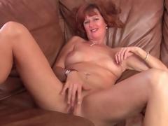 Naked solo mature redhead masturbates twat