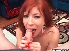 Redhead milf with arousing big bazookas gives a cook jerking