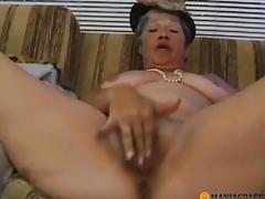 Old wench stroking her hirsute juicy crack